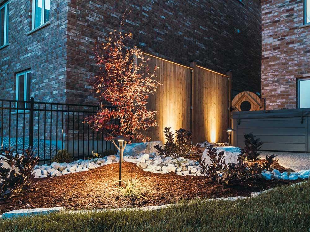 Backyard Garden With Outdoor Lighting In Kitchener