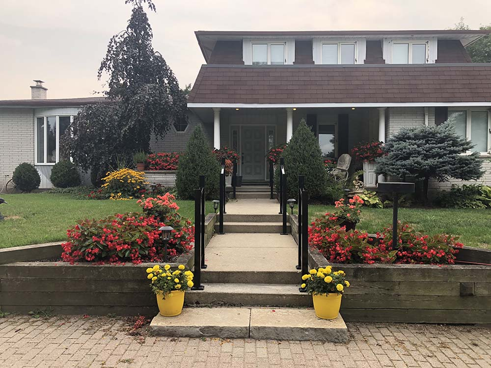 Entrance Of Kitchener Home With Garden Color